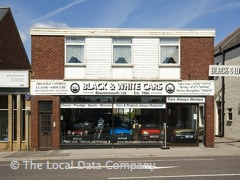 Black and White Cars Vintage Car Showroom